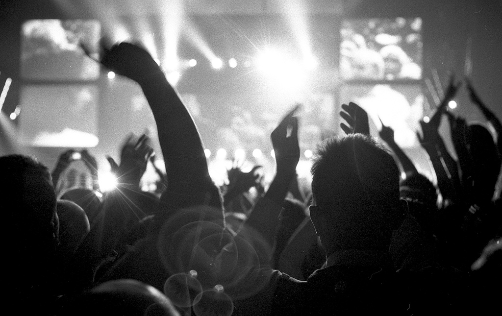 Crowd cheering a rock band onstage